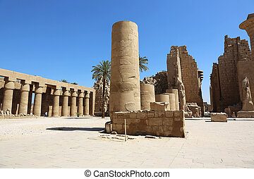 columns of the Great Forecourt with the first Pylon in the Karnak Temple, Precinct of Amun-Re, in Luxor Egypt