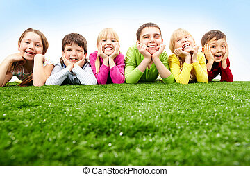 Great friends - Image of happy boys and girls lying on a...