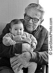 Great Granddad hug his great grandchild during home visit....