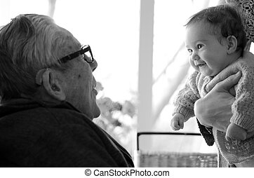 Great Granddad play with his great grandchild during home...