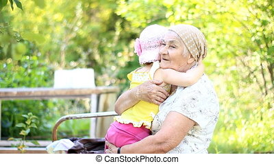 Grandmother and granddaughter play and hug
