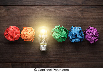 great idea concept with crumpled colorful paper and light ...