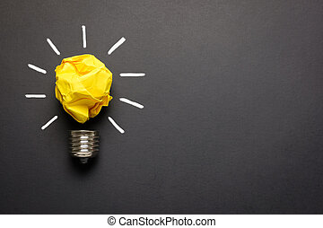 Great idea concept with crumpled yellow paper light bulb