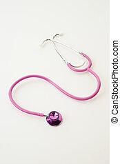 pink stethoscope on white
