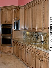 lovely kitchen with granite stone and wood cabinets