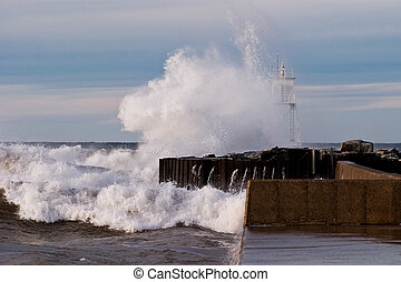 Great Lakes Waves Crashing into Harbor Light