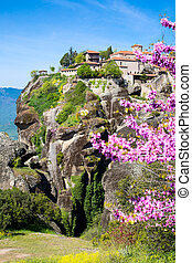 Great Meteoro Monastery in Meteora through the Branch of pink blossom