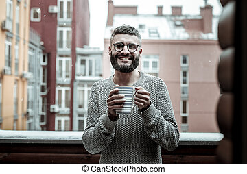 Cheerful bearded man showing his positive emotions
