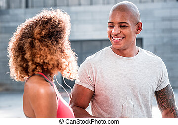 Cheerful happy man smiling to his girlfriend