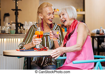 Delighted aged women having a conversation