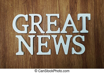 Great News word alphabet letters on wooden background