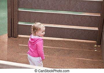 Great outdoors - Cute caucasian toddler girl walking around ...