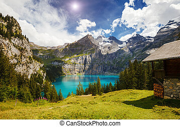 Great panorama of the azure pond Oeschinensee. Location...