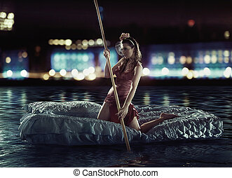 Great photo of an attractive sculling woman