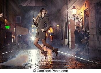 Great portrait of jumping joyful girl