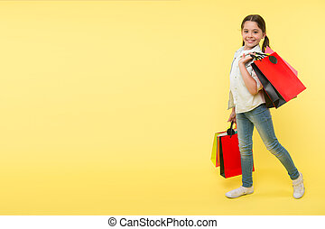 Great school shopping deals. Back to school season great time to teach budgeting basics children. Girl carries shopping bags. Prepare for school season buy supplies stationery clothes in advance