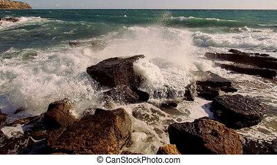 Great shot of breaking ocean waves wild water on a windy day