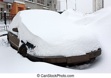 great snowfall covered car in city