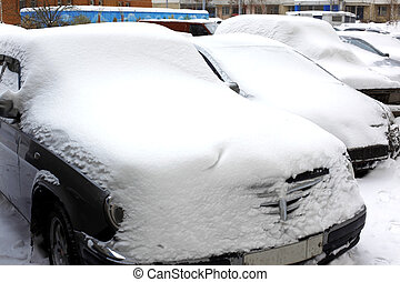 great snowfall covered cars in city