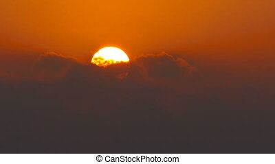 great sun rising between clouds, telephoto lens - great sun...