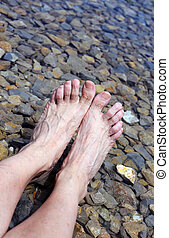 tired feet on the shore of the Lake