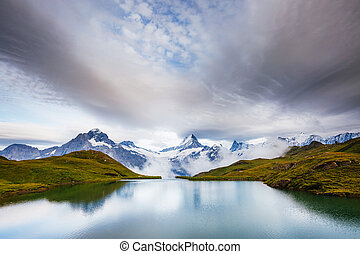 Great view of Mt. Schreckhorn and Wetterhorn above Bachalpsee lake. Location Swiss alp, Bernese Oberland, Grindelwald, Europe.