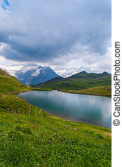 Great view of the rocky mountains. Popular tourist attraction. Location place Bachalpsee in Swiss Alps, Grindelwald valley, Bernese Oberland, Europe