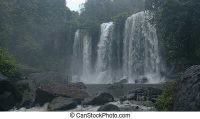 Great waterfall in the rain forest. Unprocessed, low-...
