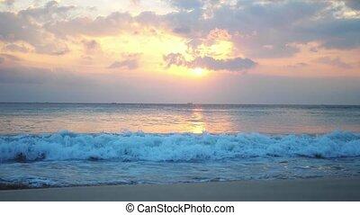 Great waves of a powerful ocean break into foam during...
