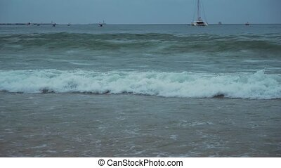 Great waves of South China Sea on Dadonghai beach in the early morning stock footage video