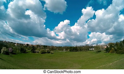 Great White Fluffy Clouds Moving Over the Field