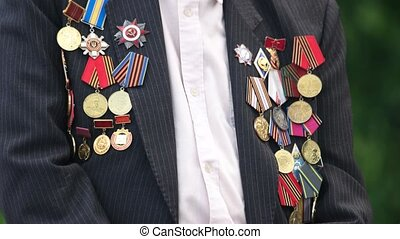 Great world war veteran with medals. Close up. Jacket with...