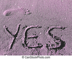 written YES engraved on the sand of the Sea Beach and a foot foo