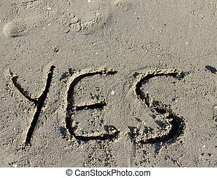 written YES engraved on the sand of the Sea Beach