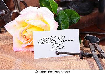 Greatest Dad - The congratulatory card on a desktop in a...
