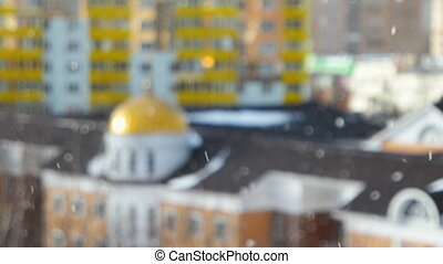 Grebnevskaya church, Odintsovo, Moscow region, Russia. Winter sunny snowy day. Blurred background, falling snow in focus.