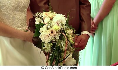 Grecian Wedding - video footage of wedding cuple putting...
