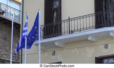 Greece and EU flags by the building