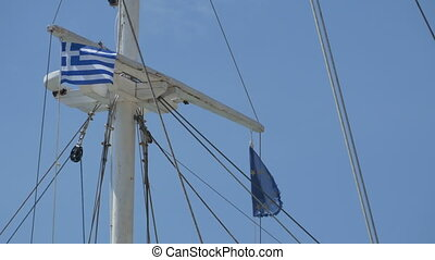 Greece and EU Flags on Mast - Tiny flags on old ship mast.