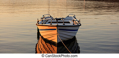 Greece, Boat in the sea at sunset