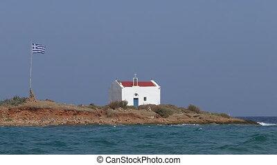 Greece flag and church on island