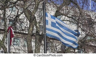 Greece Flag at flagpole in city