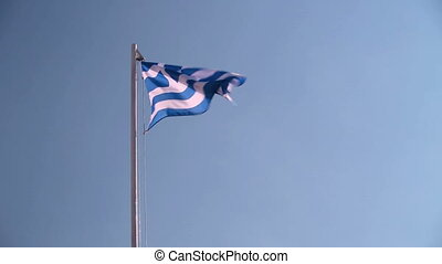 Greece flag in front of a blue sky