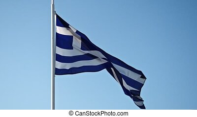Greece flag waving in the wind against the sky