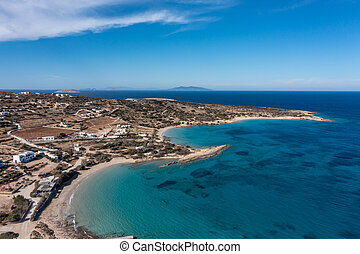 Greece, Koufonisi island, sandy secluded beaches, aerial drone view. Small Cyclades breathtaking nature, Italida, Fanos beach, turquoise sea water, blue sky background.