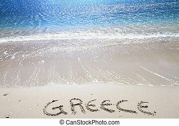 """Greece? written on sandy beach"