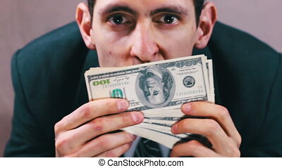 Greedy Businessman sniffing money.
