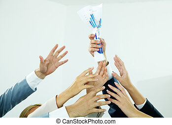 Greedy for paper - Image of several human hands trying to...