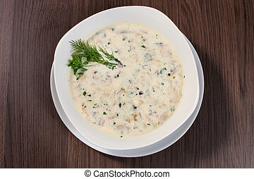 Greek chicken soup in a bowl isolated on white / Greek chicken soup isolated / Greek chicken soup with herbs