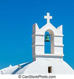 Greek church bell against blue sky